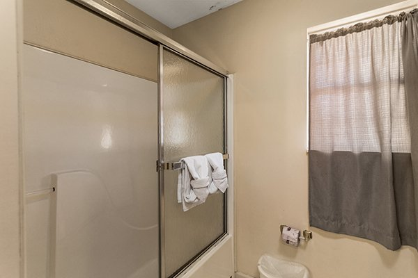 Bathroom with a tub and shower at Chalet Mignon, an 8-bedroom cabin rental located in Gatlinburg