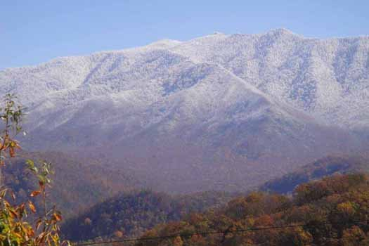 Snow-capped Smoky Mountains seen from Chalet Mignon, an 8-bedroom cabin rental located in Gatlinburg
