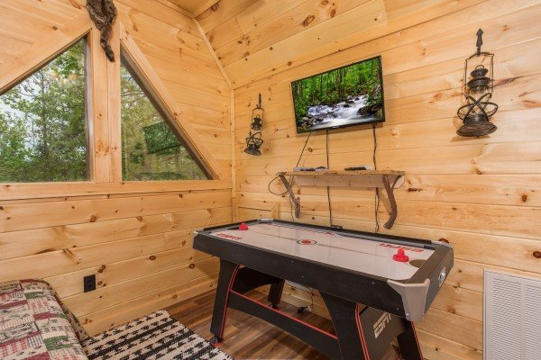 Air hockey table in the loft at Gatlinburg Treehouse, a 1-bedroom cabin rental located in Gatlinburg