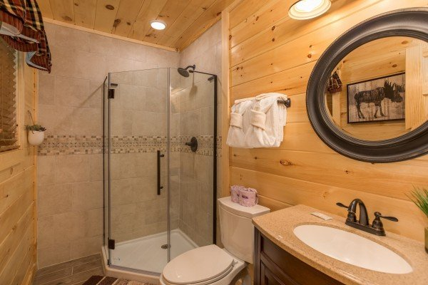 Bathroom with a glassed in shower at Gatlinburg Treehouse, a 1-bedroom cabin rental located in Gatlinburg