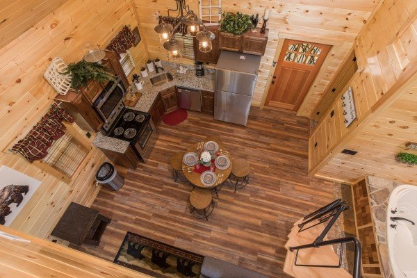 Looking down from the loft space onto the main floor at Gatlinburg Treehouse, a 1-bedroom cabin rental located in Gatlinburg