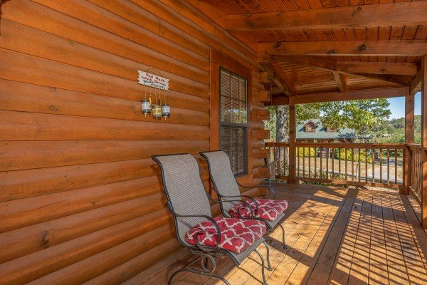 Chairs on a covered deck at Bearadise 4 Us, a 3 bedroom cabin rental located in Pigeon Forge