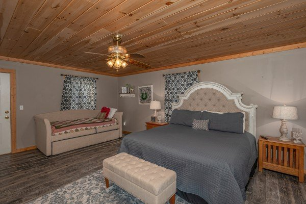 Bedroom with a king bed and sleeper sofa at Bearadise 4 Us, a 3 bedroom cabin rental located in Pigeon Forge