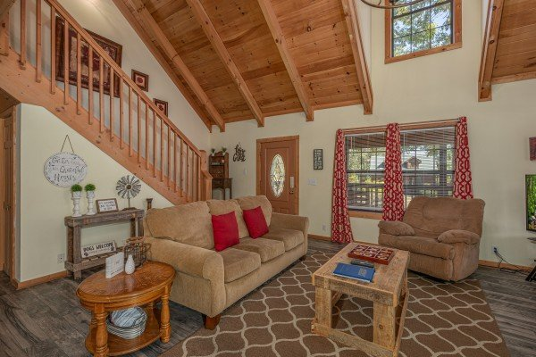 Living room with sofa and chair at Bearadise 4 Us, a 3 bedroom cabin rental located in Pigeon Forge
