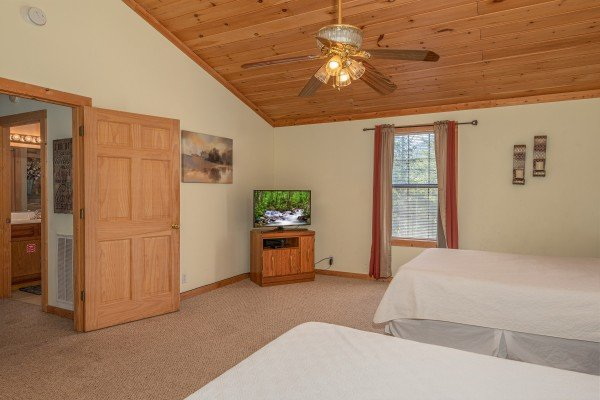 TV in a bedroom at Bearadise 4 Us, a 3 bedroom cabin rental located in Pigeon Forge