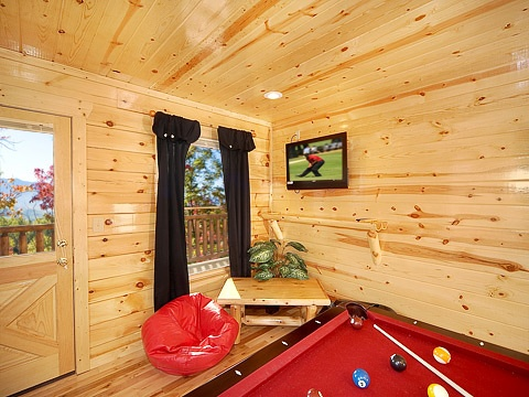 Deck access from game room at Natural Wonder, a 4 bedroom cabin rental located in Gatlinburg