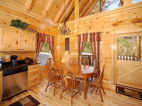 dining room area at natural wonder a 4 bedroom cabin rental located in gatlinburg