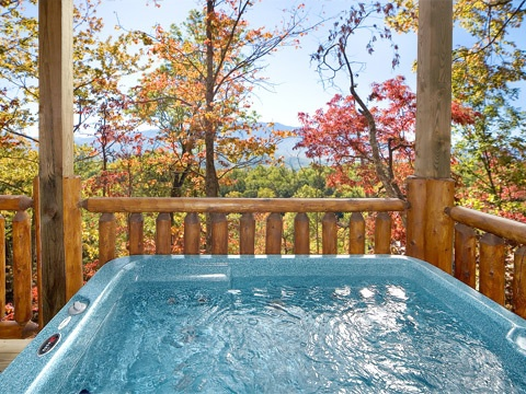 First floor deck with hot tub at Natural Wonder, a 4 bedroom cabin rental located in Gatlinburg