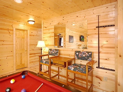 game room seating on first floor at natural wonder a 4 bedroom cabin rental located in gatlinburg