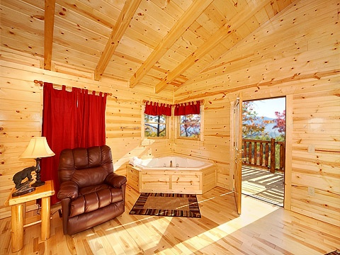 jacuzzi tub and recliner at natural wonder a 4 bedroom cabin rental located in gatlinburg