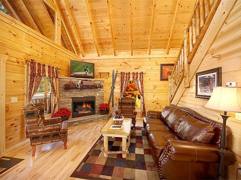 living room with fireplace at natural wonder a 4 bedroom cabin rental located in gatlinburg