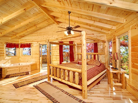 Third floor king bedroom with jacuzzi tub at Natural Wonder, a 4 bedroom cabin rental located in Gatlinburg