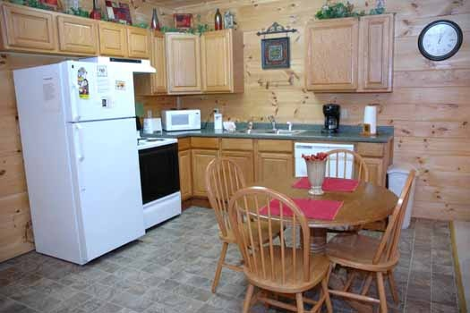 kitchen and dining room area at whispering creek a 1 bedroom cabin rental located in gatlinburg