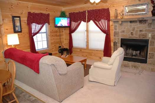 living room with fireplace at whispering creek a 1 bedroom cabin rental located in gatlinburg