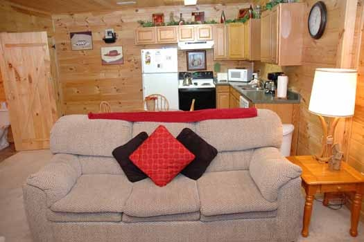 living room with sofa bed at whispering creek a 1 bedroom cabin rental located in gatlinburg