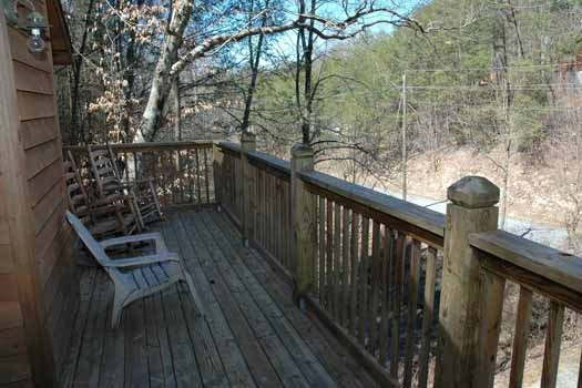 upper deck with chairs at whispering creek a 1 bedroom cabin rental located in gatlinburg