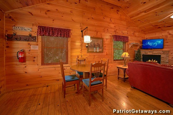 Dining table with seating for four at Bear House Rock, a 3-bedroom cabin rental located in Pigeon Forge