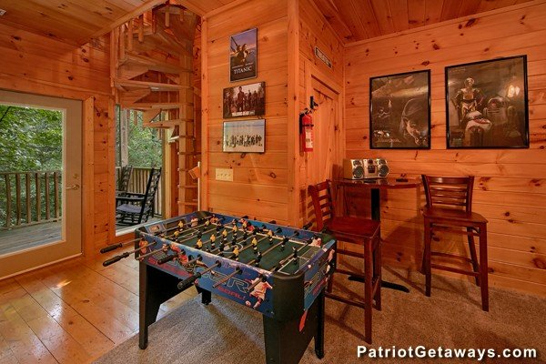 Foosball table at Bear House Rock, a 3-bedroom cabin rental located in Pigeon Forge
