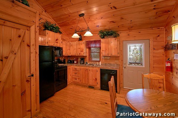 Kitchen with black appliances at Bear House Rock, a 3-bedroom cabin rental located in Pigeon Forge