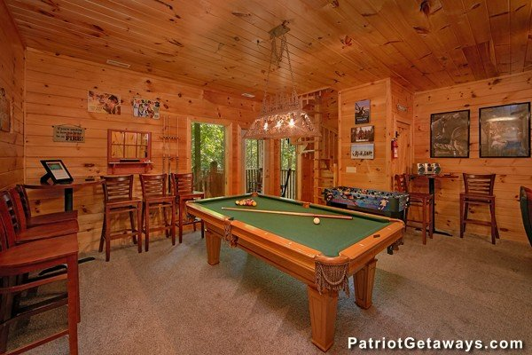 Pool table in the game room at Bear House Rock, a 3-bedroom cabin rental located in Pigeon Forge