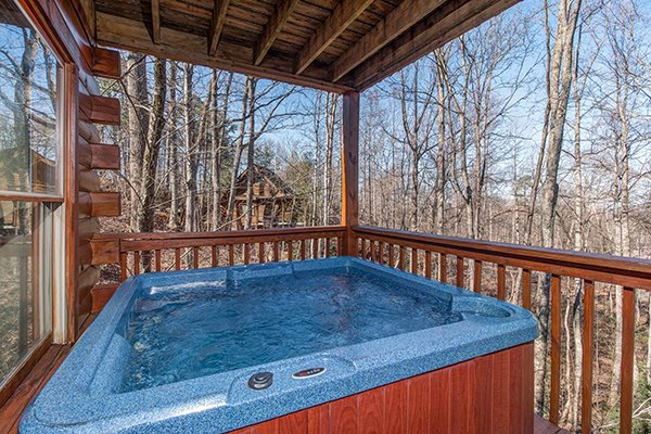 Hot tub on a covered deck at Sunny Side Up, a 2 bedroom cabin rental located in Gatlinburg