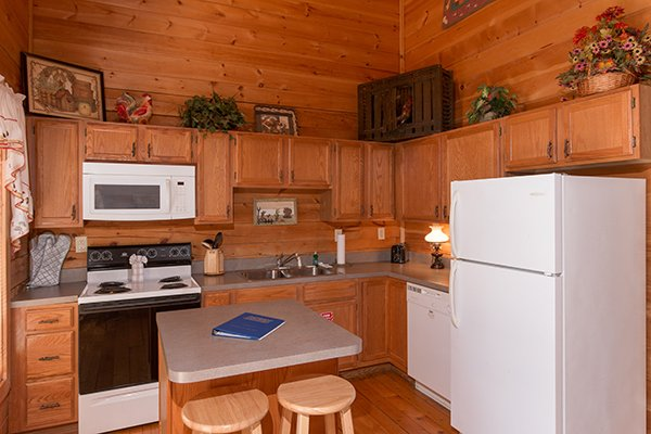 Kitchen with white appliances at Sunny Side Up, a 2 bedroom cabin rental located in Gatlinburg