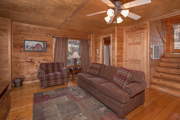 Sofa and chair in the living room at Sunny Side Up, a 2 bedroom cabin rental located in Gatlinburg