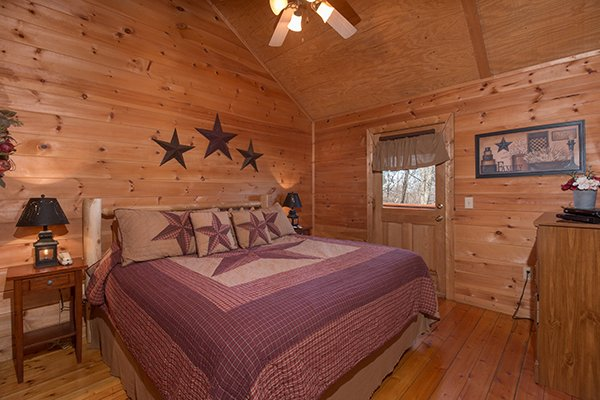 Bedroom with a king bed and deck access at Sunny Side Up, a 2 bedroom cabin rental located in Gatlinburg
