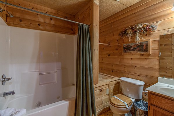 Bathroom with a tub and shower at Sunny Side Up, a 2 bedroom cabin rental located in Gatlinburg
