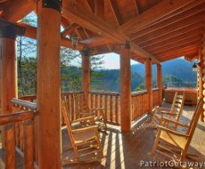 Deck and rocking chairs at sunset at Taj Mahal, a 3 bedroom cabin rental located in Pigeon Forge