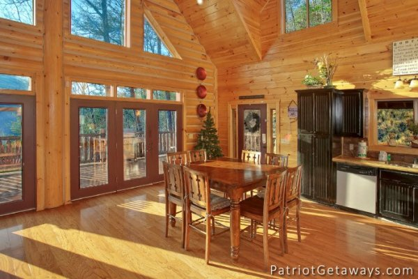 Dining space for 8 at Taj Mahal, a 3 bedroom cabin rental located in Pigeon Forge