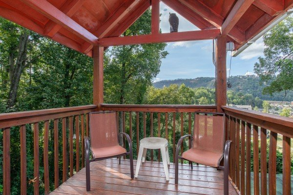 Deck with two chairs and a mountain view at Shiloh, a 3 bedroom cabin rental located in Gatlinburg