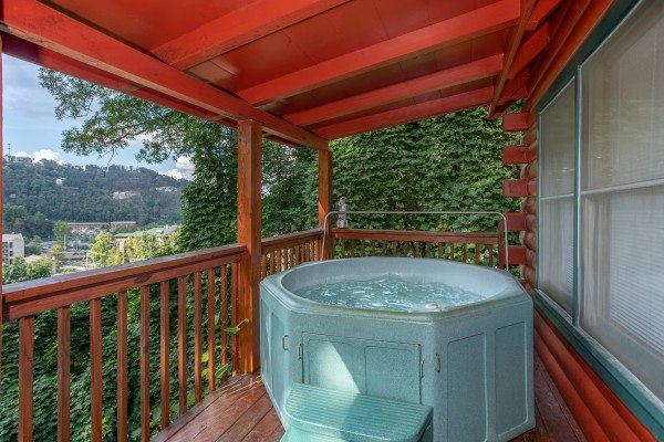 Round hot tub on the covered deck at Shiloh, a 3 bedroom cabin rental located in Gatlinburg
