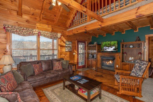Living room with a fireplace and TV at Shiloh, a 3 bedroom cabin rental located in Gatlinburg