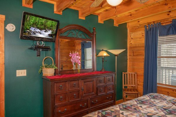Bedroom with a dresser and TV at Shiloh, a 3 bedroom cabin rental located in Gatlinburg