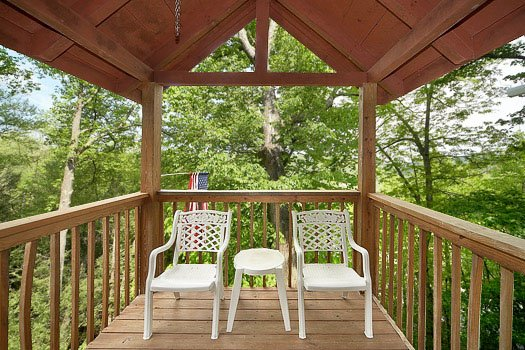 Third floor covered deck at Shiloh, a 3 bedroom cabin rental located in Gatlinburg