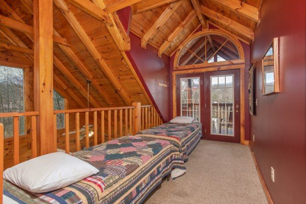 Twin beds on the upper level at Shiloh, a 3 bedroom cabin rental located in Gatlinburg