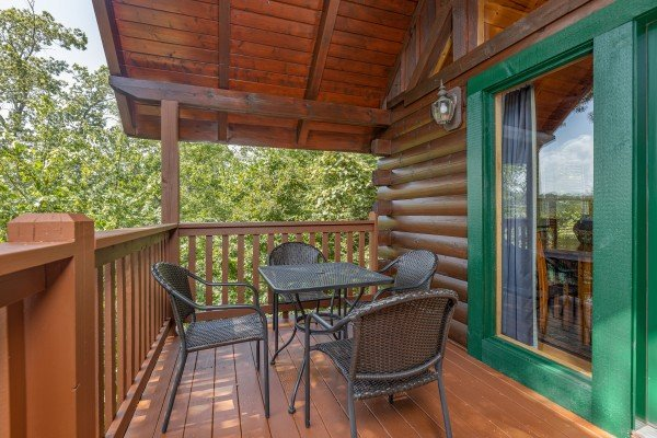 Deck table for four at Private Indulgences, a 2 bedroom cabin rental located in Gatlinburg