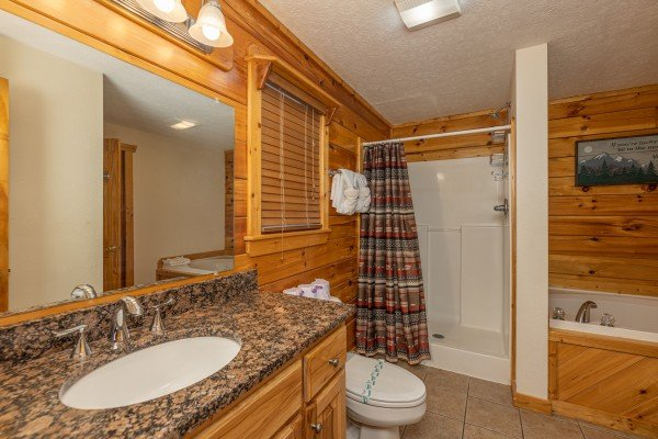 Bathroom with a large shower and jacuzzi at Private Indulgences, a 2 bedroom cabin rental located in Gatlinburg