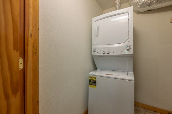 Stacked washer and dryer at Private Indulgences, a 2 bedroom cabin rental located in Gatlinburg