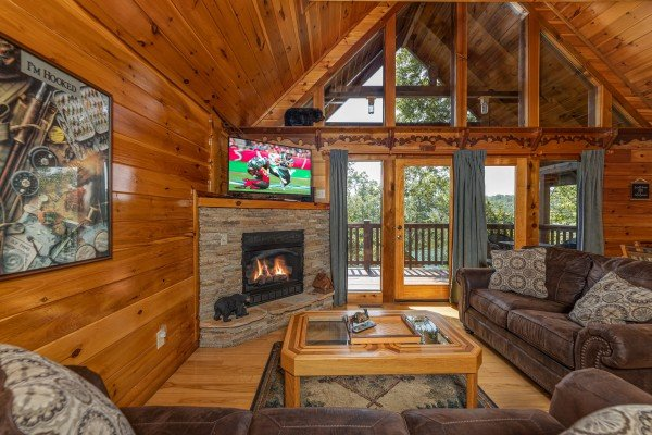 Living room with fireplace and TV at Private Indulgences, a 2 bedroom cabin rental located in Gatlinburg