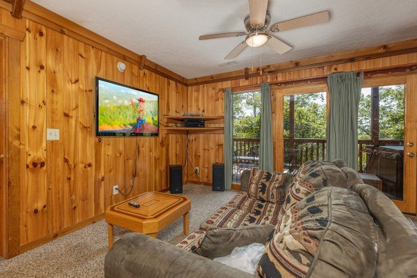 TV in the lower living room at Private Indulgences, a 2 bedroom cabin rental located in Gatlinburg