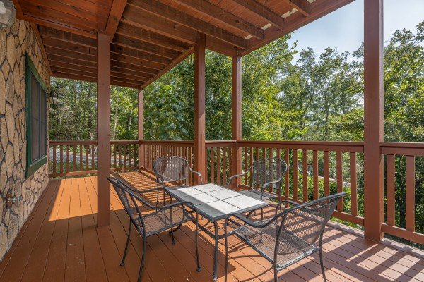 Dining table for four at Private Indulgences, a 2 bedroom cabin rental located in Gatlinburg