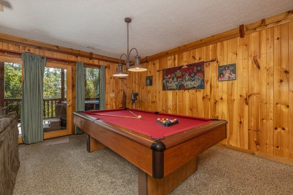 Red felt pool table at Private Indulgences, a 2 bedroom cabin rental located in Gatlinburg