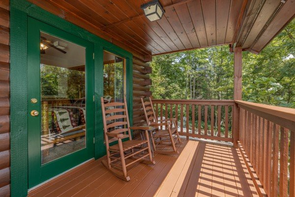 Rocking chairs on a covered deck at Private Indulgences, a 2 bedroom cabin rental located in Gatlinburg