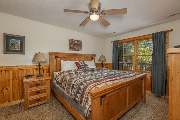 Bedroom with queen bed, night stands, lamps at Private Indulgences, a 2 bedroom cabin rental located in Gatlinburg