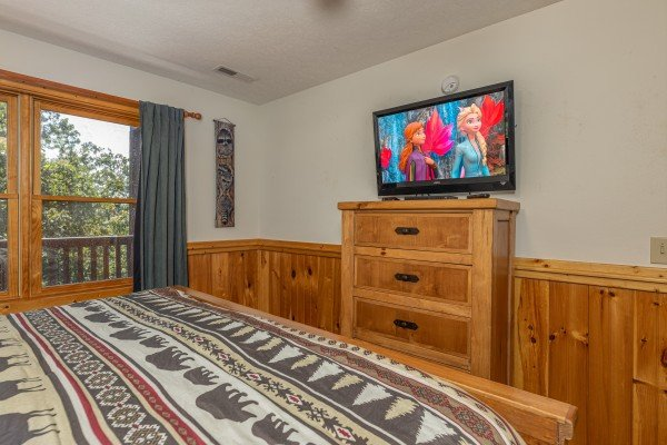 Dresser and TV in a bedroom at Private Indulgences, a 2 bedroom cabin rental located in Gatlinburg