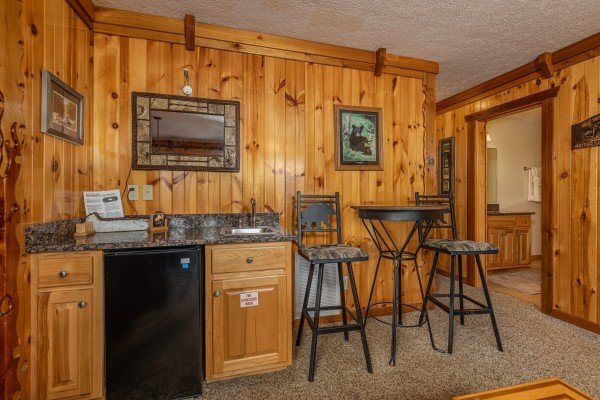 Wet bar with sink, fridge, and a table and chairs at Private Indulgences, a 2 bedroom cabin rental located in Gatlinburg