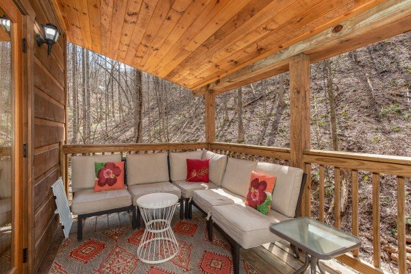 Comfortable deck seating at My Smoky Mountain Hideaway, a 3 bedroom cabin rental located in Pigeon Forge