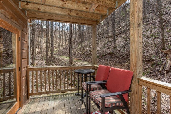 Covered deck with seating at My Smoky Mountain Hideaway, a 3 bedroom cabin rental located in Pigeon Forge